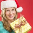 Beautiful Woman Holding Christmas Present — Stock Photo