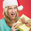 Surprised Woman Holding Christmas Present — Stock Photo