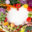 Assortment of Fresh Vegetables and Fruits Making Heart Shape — Stock Photo #28943471