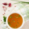 Bone Broth in Small Soup Bowl Served with Fresh Herbs, Garlic and Spices — Foto Stock