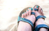 White Sand on Beach with Female Feet Wearing Minimal Sport Sandals in Gray Green Color — Stock Photo
