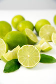 Organic Limes Whole and Halved — Stock Photo