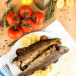 two whole trouts fried in pan — Stock Photo