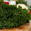 Fresh Organic Kale Leaves on Wooden Cutting Board with Knife — Stock Photo