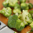 Chopped and Ready to be Cooked Broccoli Florets on Cutting Board — Stock Photo #29053555