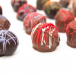 Assorted Chocolate Truffles on White Background — Stock Photo