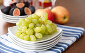 Juicy Green Grapes and Other Fruit on Platter — Stock Photo