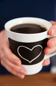Hands Holding Coffee Cup with Chalk Heart — Stock Photo