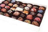 Assorted Chocolate Truffles on White Background — Stock Photo