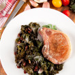 Pork Chop and Wilted Rainbow Chard — Stock Photo