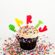 Chocolate Cupcake with Candles Saying 'Party' — Stock Photo