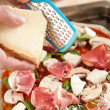 Grating Parmesan Cheese on Fresh Homemade Pizza — Stock Photo