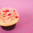 Cute Vanilla Strawberry Cupcake with Pink Heart Sprinkles — Stock Photo #29077251