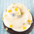 Stock Photo: Cute Chocolate Cupcake with Buttercream Icing and Star Sprinkles