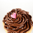 Vanilla Cupcake with Heart Candy — Stock Photo