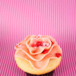 Vanilla Strawberry Cupcake with Heart Candy — Stock Photo