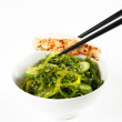 Bowl of Healthy Seaweed Salad with Piece of White Fish — Stock Photo