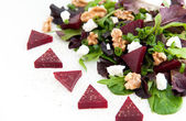 Beet Salad with Goat Cheese, Candied Walnuts, Spring Greens, and Herbs — Stock Photo