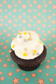 Cute Chocolate Cupcake with Buttercream Icing and Star Sprinkles — Stock Photo