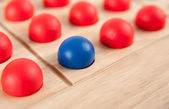 One Blue Sphere with Lots of Red Ones Leadership Concept — Stock Photo