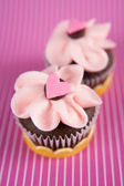 Two Chocolate Cupcakes with Tiny Heart Candy on Top — Stock Photo