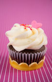 Cute Chocolate Cupcake with Tiny Heart Candy on Top — Stock Photo
