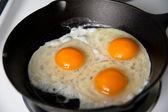 Eggs Being Fried on Cast Iron Skillet — Stock Photo
