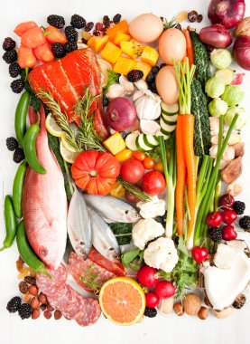 Healthy Food Assortment with Fish, Eggs, Vegetables, Fruit and Cured Meats for Healthy Diet full of Antioxidants and Vitamins