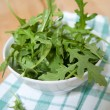 Fresh Baby Arugula Greens in White Bowl — Stock Photo