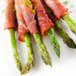 Fresh Young Asparagus Wrapped in Prosciutto Meat and Grilled — Stock Photo
