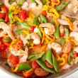 Shrimp, Tomatoes, Bell Peppers and Snap Peas Sauteed in Coconut Milk — Stock Photo #29081809