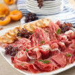Party Platter of Assorted Cured Meats, Fruit and Crackers — Stock Photo
