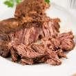 Foto de Stock  : Big Piece of Slow Cooked Grass Fed Organic Beef