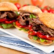 Stock Photo: Plate of Three Small Slider Sandwiches with Pulled Beef and Red Bell Peppers