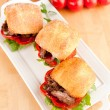 Plate of Three Small Slider Sandwiches with Pulled Beef and Red Bell Peppers — Stock Photo #29083953