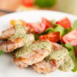 Pork Tenderloin with Cilantro Pesto Served Over Arugula and Tomato Salad — Stock Photo