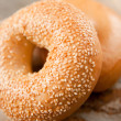 Freshly Baked Sesame Seed and Plain Bagels — Stock Photo