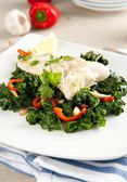 Grilled Cod Served Over Freshly Wilted Kale and Chard — Stock Photo