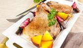 Closeup of Two Pork Chops Served with Roasted Root Vegetables — Stock Photo