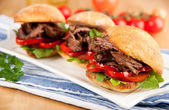 Plate of Three Small Slider Sandwiches with Pulled Beef and Red Bell Peppers — Stock Photo