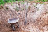 Wheelbarrow and shovel — Photo