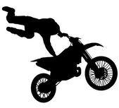 Silhouette of a motorcycle stuntman — Stock Photo