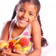 Cute smiling girl with various fruits — Stock Photo #29652813