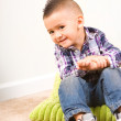 Adorable baby boy portrait sitting on a pillow — Stockfoto