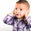 Adorable baby boy with his hands closing his ears — Stock Photo #29652895
