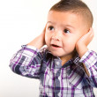 Adorable baby boy with his hands closing his ears — Stock Photo