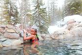 Girl in hot springs — Stock Photo