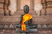 Bronze Buddha statue at the Haw Phra Kaew — Stock Photo