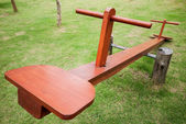 Empty wooden seesaw in a park — Stock Photo