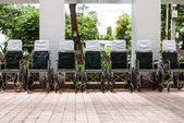 Wheelchairs parked outside a hospital — Stock Photo